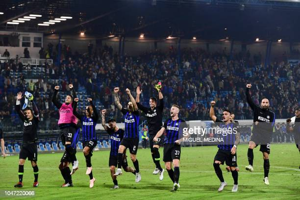 Inter Milan aplayers celebrate after the Italian Serie A football match between Spal and Inter Milan in Ferrara on October 7 2018