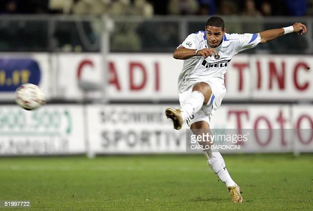 Inter Milan Brazilian forward Adriano shoots in an Italian serie A football match against Reggina in Reggio Calabria 15 January 2005 The match ended...