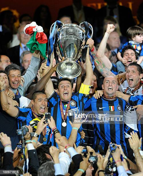 Inter Milan captain Javier Zanetti and team celebrate with the trophy after winning the UEFA Champions League Final match between Bayern Munich and...