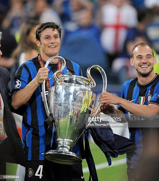 Inter Milan captain Javier Zanetti and Wesley Sneijder celebrate with the trophy after winning the UEFA Champions League Final match between Bayern...