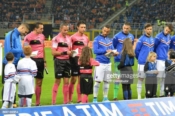 Inter Milan captain Mauro Icardi Sampdoria counterpart Fabio Quagliarella and referee Marco Guida sign copies of The Diary of Anne Frank and Italian...