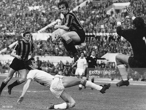 Inter Milan centreforward Pino Boninsegna leaps high over Lazio's Giorgio Papadopulo during their match at the Olympic Stadium in Rome On the left is...