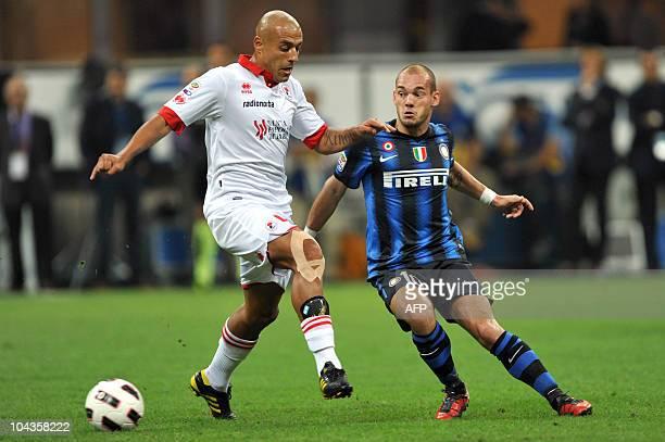 Inter Milan Dutch midfielder Wesley Sneijder challenges for the ball with Bari's Argentine midfielder Sergio Bernardo Almiron during the Serie A...