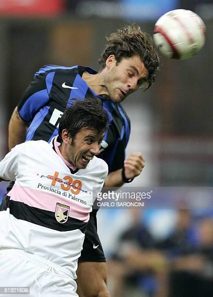 C Inter Milan forward Christian Vieri and Palermo US Giuseppe Biava in a Serie A match at San Siro Stadium in Milan 18 September 2004