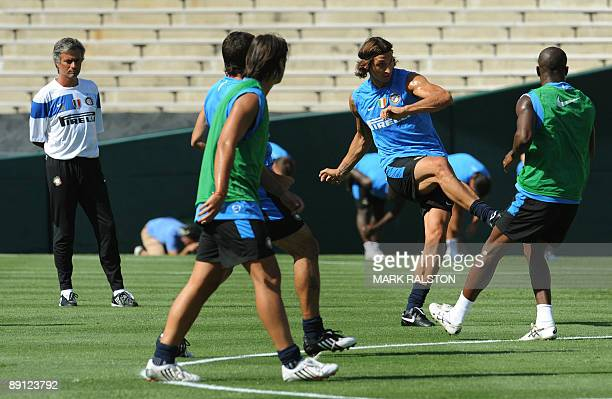 Inter Milan forward Zlatan Ibrahimovic kicks the ball as coach José Mourinho watches during training at the Rose Bowl on the eve of their game...