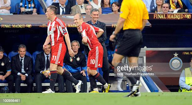 Inter Milan manager Jose Mourinho smiles as he gives the loose ball to Argen Robben of Bayern Munich during the UEFA Champions League Final match...