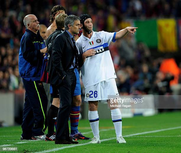 Inter Milan manager Jose Mourinho talks to Cristian Chivu of Inter Milan during the UEFA Champions League Semi Final Second Leg match between...