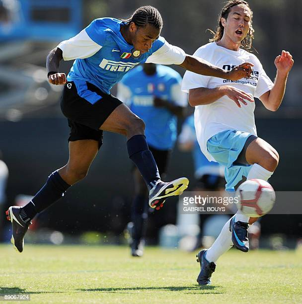 Inter Milan midfielder Joel Obi from Nigeria kicks the ball in front of UCLA defender Anthony Avalos during a practice game against UCLA in Westwood...