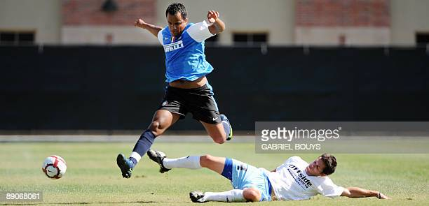 Inter Milan midfielder Mancini from Brazil outpasses UCLA defender Danny Suits during a practice game against UCLA in Westwood California on July 16...