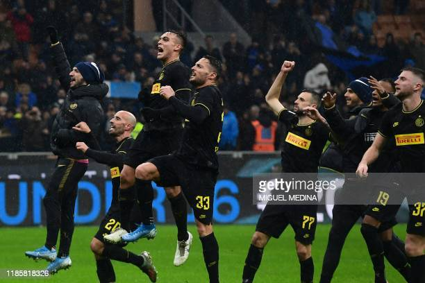 Inter Milan players celebrate after winning the Italian Serie A football match between Inter Milan and SPAL on December 1 at the San Siro stadium in...