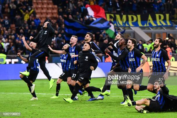 Inter Milan players celebrate at the end of the Italian Serie A football match Inter Milan vs AC Milan on October 21 2018 at the San Siro stadium in...
