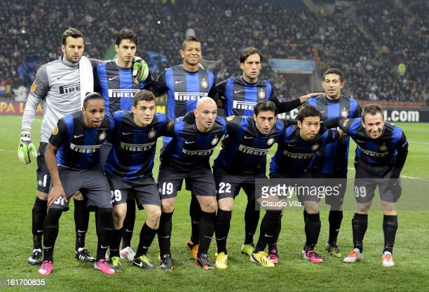 Inter Milan players line up for a team photo before the start of the UEFA Europa League round of 32 first leg match between FC Internazionale Milano...