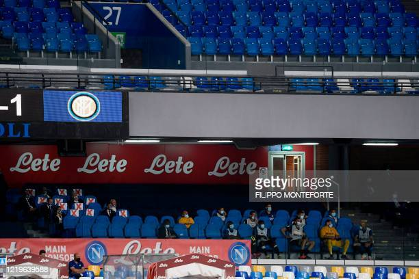 Inter Milan substitutes and staff watch the Italian Cup semi-final second leg football match Napoli vs Inter Milan on June 13, 2020 at the San Paolo...
