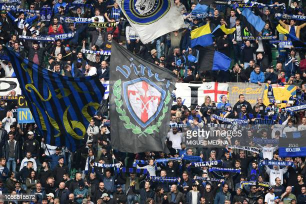 Inter Milan supporters cheer their team during the Italian Serie A football match between Inter Milan and Genoa at the San Siro stadium in Milan on...