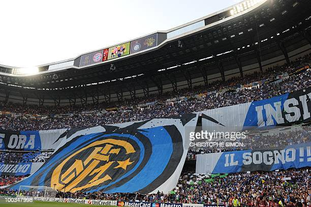 Inter Milan supporters wafe a huge falg before the UEFA Champions League final football match Inter Milan against Bayern Munich at the Santiago...