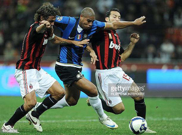Inter Milan's Adriano fights for the ball with AC Milan's Paolo Maldini and Gianluca Zambrotta during their Serie A football match at Milan's San...