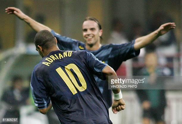 Inter Milan's Adriano runs in celebration in front of his teammate Andy Van der Meyde after scoring against Werder Bremen during their Group G...