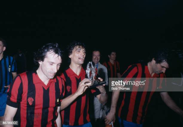 Inter Milan's Alessandro Altobelli carrying the trophy after they had beaten AC Milan in the final of the Copa Super Clubs at the San Siro Stadium in...