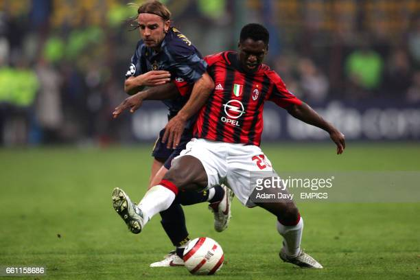 Inter Milan's Andy Van der Meyde and AC Milan's Clarence Seedorf battle for the ball
