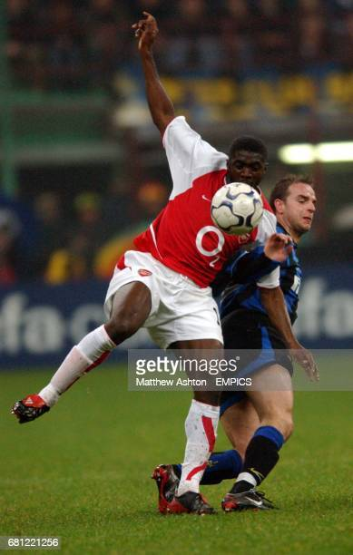 Inter Milan's Andy van der Meyde and Arsenal's Kolo Toure battle for the ball