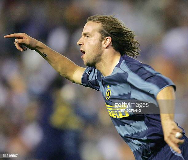 Inter Milan's Andy Van Der Meyde celebrates after scoring Inter's third goal against Valencia during their Champions League Group G football match at...