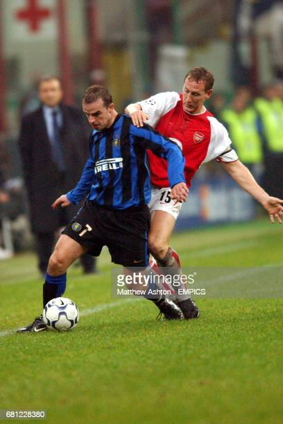 Inter Milan's Andy van der Meyde shields the ball from Arsenal's Ray Parlour