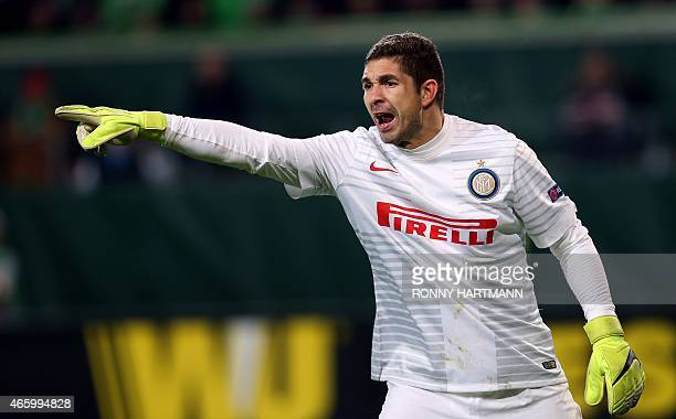 Inter Milan's Argentinan goalkeeper Juan Pablo Carrizo gestures during the UEFA Europa League firstleg Round of 16 football match VfL Wolfsburg vs FC...