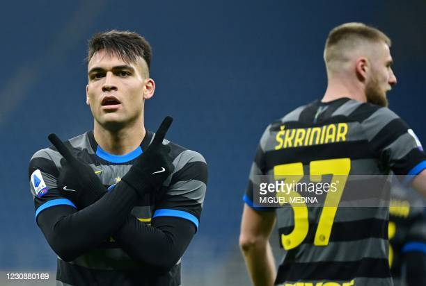 Inter Milan's Argentine forward Lautaro Martinez celebrates after scoring a goal during the Italian Serie A football match beetween Inter Milan and...