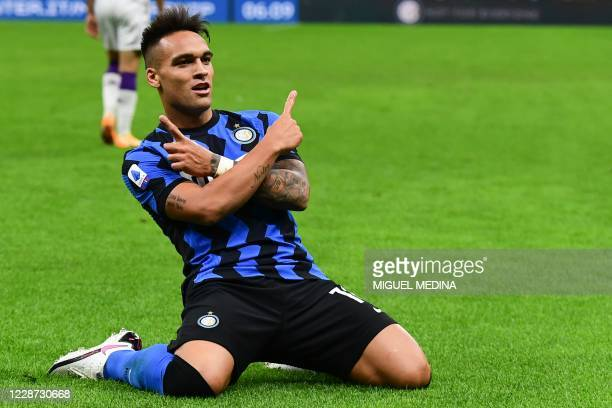 Inter Milan's Argentine forward Lautaro Martinez celebrates after Fiorentina scored an own goal during the Italian Serie A football match Inter vs...
