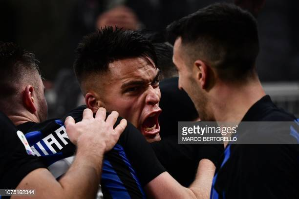 Inter Milan's Argentine forward Lautaro Martinez celebrates after opening the scoring during the Italian Serie A football match Inter Milan vs Napoli...
