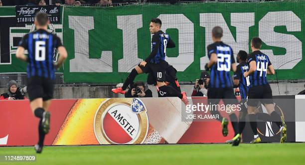 Inter Milan's Argentine forward Lautaro Martinez celebrates scoring with his teammates during the UEFA Europa League round of 32 firstleg football...