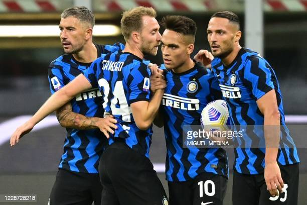 Inter Milan's Argentine forward Lautaro Martinez celebrates with (From L° Inter Milan's Serbian defender Aleksandar Kolarov, Inter Milan's Danish...