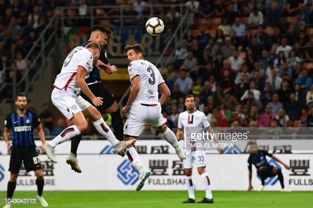 Inter Milan's Argentine forward Lautaro Martinez heads the ball to open the scoring during the Italian Serie A football match Inter Milan vs Cagliari...