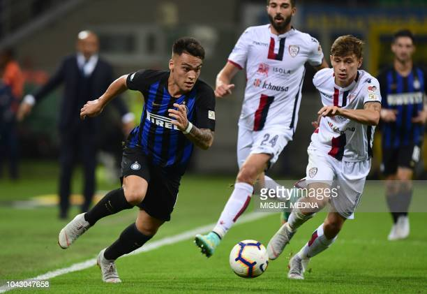 Inter Milan's Argentine forward Lautaro Martinez outruns Cagliari's Italian midfielder Nicolo Barella during the Italian Serie A football match Inter...
