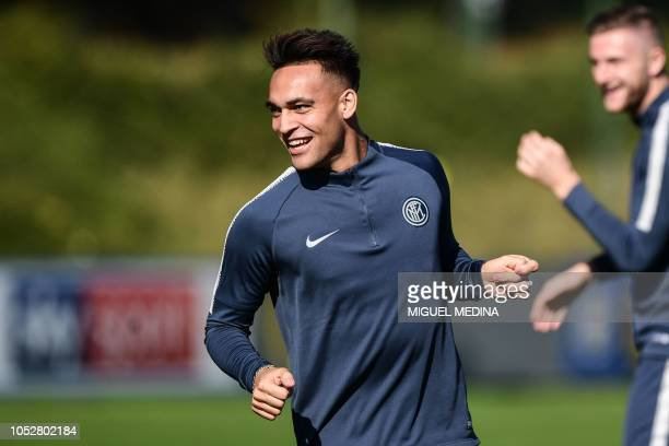 Inter Milan's Argentine forward Lautaro Martinez smiles during a training session on October 23 2018 at the Appiano Gentile training ground near Como...