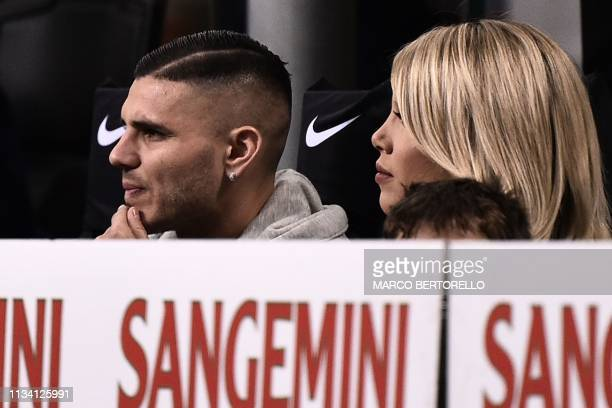 Inter Milan's Argentine forward Mauro Icardi and his wife, Argentine media personality and football agent, Wanda Nara attend the Italian Serie A...
