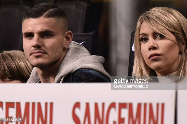 Inter Milan's Argentine forward Mauro Icardi and his wife Argentine television personality, and football agent, Wanda Nara attend the Italian Serie A...