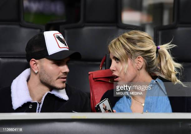 Inter Milan's Argentine forward Mauro Icardi and his wife Wanda Nara talk prior to the UEFA Europa League round of 32 secondleg football match Inter...