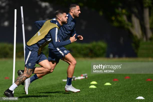 Inter Milan's Argentine forward Mauro Icardi and Inter Milan's Italian defender Danilo D'Ambrosio take part in a training session on October 2 2018...