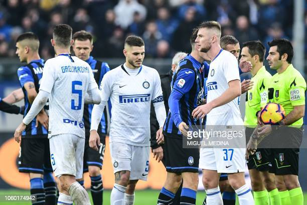 Inter Milan's Argentine forward Mauro Icardi and Inter Milan's Slovak defender Milan Skriniar react at the end of the Italian Serie A football match...