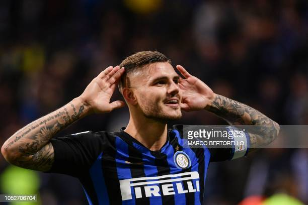 Inter Milan's Argentine forward Mauro Icardi celebrates after scoring during the Italian Serie A football match Inter Milan vs AC Milan on October 21...