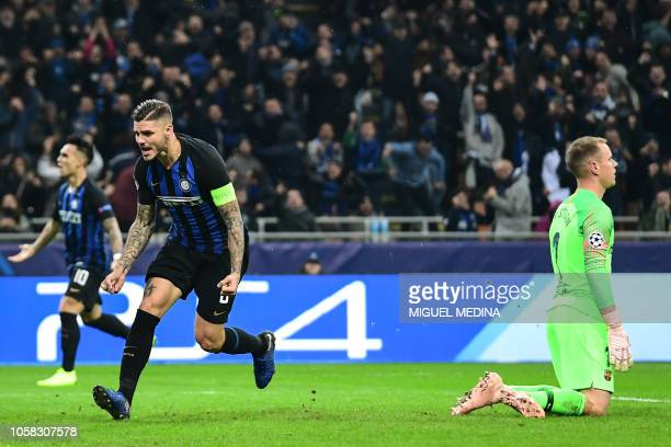 Inter Milan's Argentine forward Mauro Icardi celebrates after scoring an equalizer during the UEFA Champions League group B football match Inter...