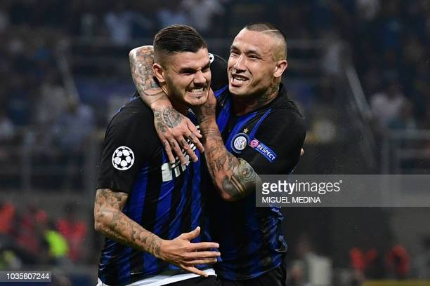 Inter Milan's Argentine forward Mauro Icardi celebrates with Inter Milan's Belgian midfielder Radja Nainggolan after scoring an equalizer during the...