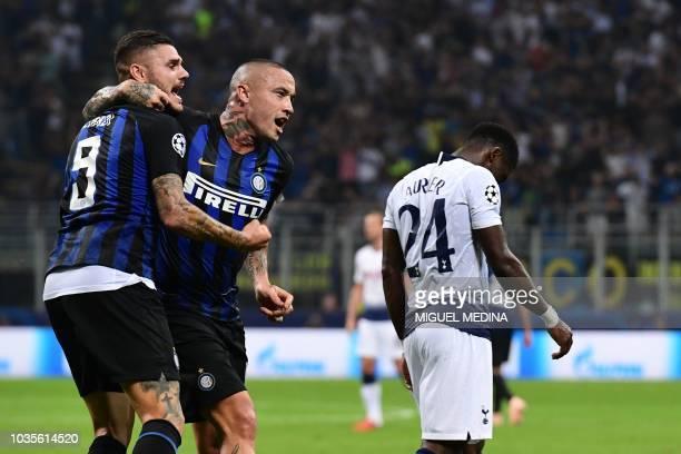 Inter Milan's Argentine forward Mauro Icardi celebrates with Inter Milan's Belgian midfielder Radja Nainggolan next to Tottenham's Ivorian defender...