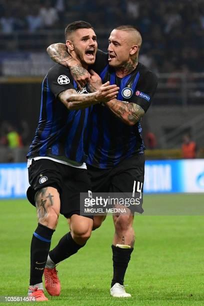 Inter Milan's Argentine forward Mauro Icardi celebrates with Inter Milan's Belgian midfielder Radja Nainggolan after scoring an equalizer during the...
