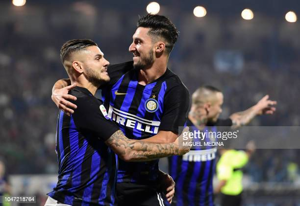Inter Milan's Argentine forward Mauro Icardi celebrates with Inter Milan's Italian midfielder Matteo Politano after scoring the second goal during...