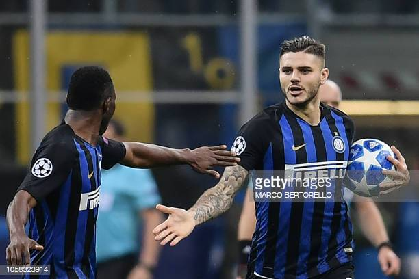 Inter Milan's Argentine forward Mauro Icardi celebrates with Inter Milan's Ghanaian midfielder Kwadwo Asamoah afer scoring an equalizer during the...