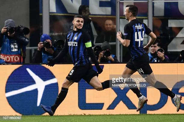 Inter Milan's Argentine forward Mauro Icardi celebrates wth Inter Milan's Croatian midfielder Ivan Perisic after scoring an equalizer during the UEFA...