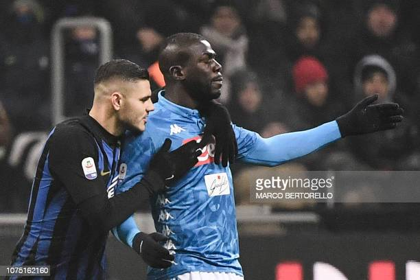 Inter Milan's Argentine forward Mauro Icardi comforts Napoli's Senegalese defender Kalidou Koulibaly after he received a red card during the Italian...