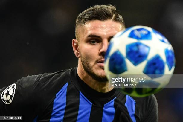 Inter Milan's Argentine forward Mauro Icardi eyes the ball during the UEFA Champions League group B football match Inter Milan vs PSV Eindhoven on...
